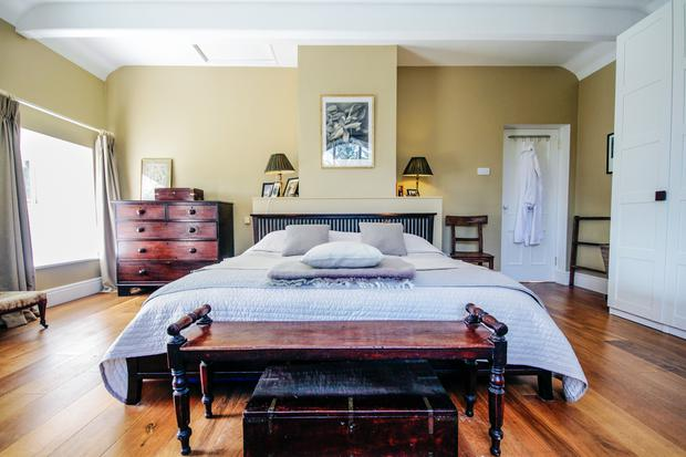 Susan Gorman and Alan Ross: Susan and Alan's bedroom in the old railway station they have renovated. Photo credit: RTE