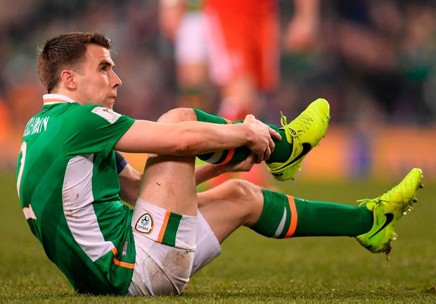 Seamus Coleman holds his leg after a horror tackle from Wales' Neil Taylor. Photo: Brendan Moran/Sportsfile