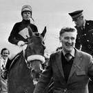 The late 'Ginger' McCain leads in the legendary Red Rum and jockey Brian Fletcher after his 1974 Grand National triumph at Aintree. Photo credit: PA Wire
