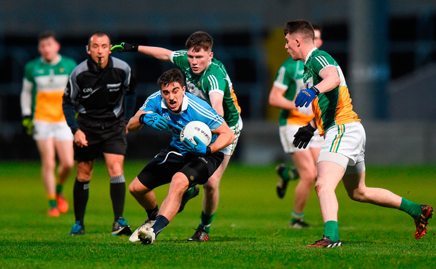 Chris Sallier of Dublin takes on Clint Horan and Patrick Dunican of Offaly, Co Laois. Photo by David Maher/Sportsfile