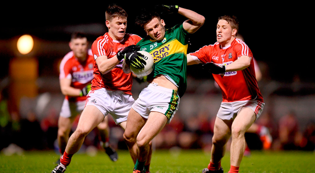 Micheál Burns of Kerry in action against Kevin O'Donovan, left, and Liam O'Donovan of Cork. Photo by Stephen McCarthy/Sportsfile
