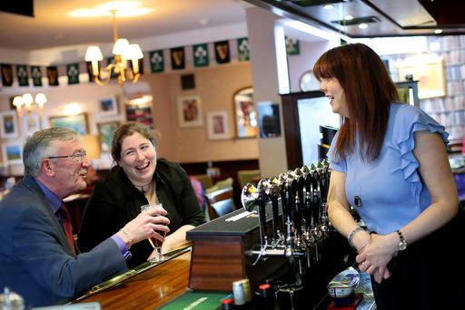 Deirdre Devitt, the first woman to take charge of the LVA in almost two centuries, talks to customers at The Two Sisters pub in Terenure, Dublin. Photo: Maxwells