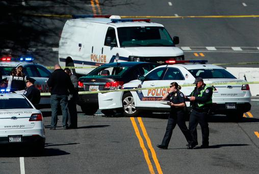 Police investigate at the scene of the incident on Capitol Hill in Washington yesterday. Photo: Getty Images