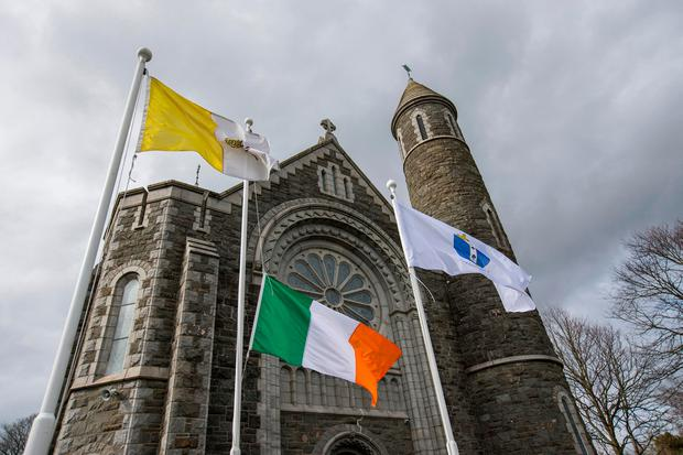 A tricolour flying at half-mast outside St Oliver Plunkett Church in Blackrock, Co Louth, where the funeral of Captain Mark Duffy will take place today. Photo: Mark Condren