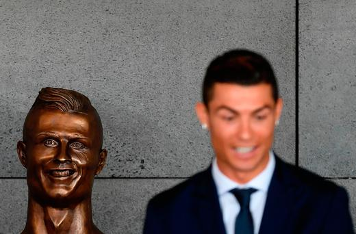 Cristiano Ronaldo beside the bust at Madeira's airport. Photo: GETTY