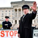 Two men dressed as customs officers during a protest at Stormont yesterday. Photo: Getty