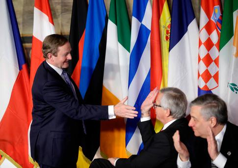 Taoiseach Enda Kenny greets European Commission President Jean-Claude Juncker (centre) after signing the Rome declaration at an EU summit meeting. Photo: AP