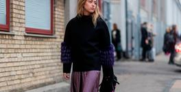 A guest wearing a black sweater, purple skirt and black Fendi backpack outside Baum & Pferdgarten at the Copenhagen Fashion Week Autumn/Winter 17 on February 1, 2017 in Copenhagen, Denmark. (Photo by Christian Vierig/Getty Images)