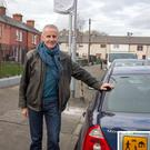 Ciaran Cuffe pictured with one of the new unveiled 30 kph signs at Linenhall St. Photo: Colin O'Riordan