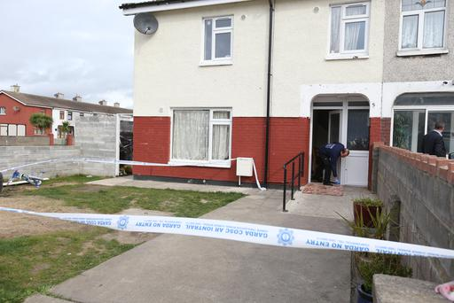 Gardai at the scene of the shooting in Coolock last night. Photo: Gerry Mooney