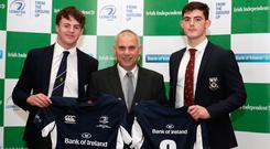 Ben O'Shea and Sean McCrohan of Clongowes Wood College are presented with their jerseys by the Irish Independent's Tony Ward. Photo: Damien Eagers