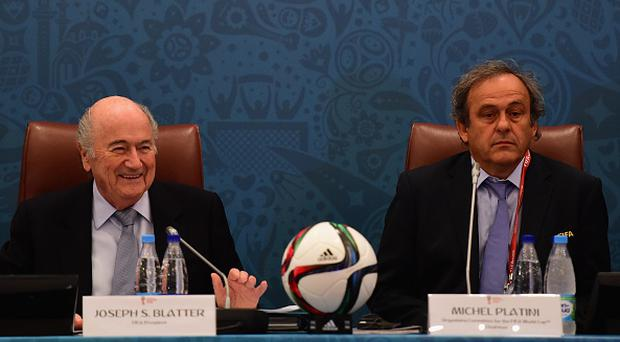 Sepp Blatter (left) with Michel Platini (right).