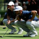 Rory McIlroy and Dustin Johnson line up their putts on the seventh hole during the final round of the WGC Mexico Championship earlier this month. Photo: Justin Heiman/Getty Images