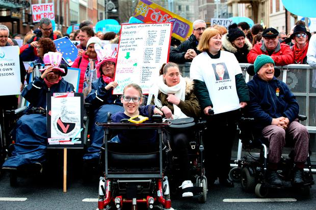 Joanne O'Riordan with other protesters outside Leinster House Photo: Tom Burke
