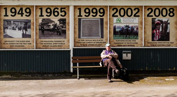 A racegoer enjoys a rest in between races at Fontwell Park yesterday. Photo: Alan Crowhurst/Getty Images