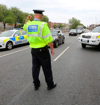 A garda from Dublin's Traffic Corps pictured at a checkpoint on Dublin's Victoria Quay. Photo: Frank McGrath