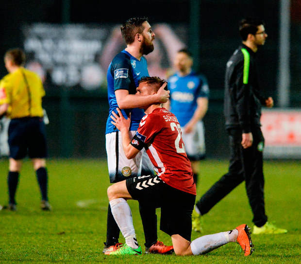 Bray's Mark Salmon consoles Derry's Lukas Schubert after the final whistle. Photo: Sportsfile