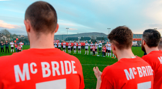 Bray Wanderers and Derry City players observe a minute's applause prior to their game in Maginn Park. Photo: Sportsfile