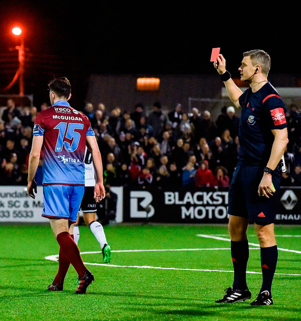 Referee Ben Connolly shows the red card to Ciaran McGuigan of Drogheda United. Photo: Sportsfile