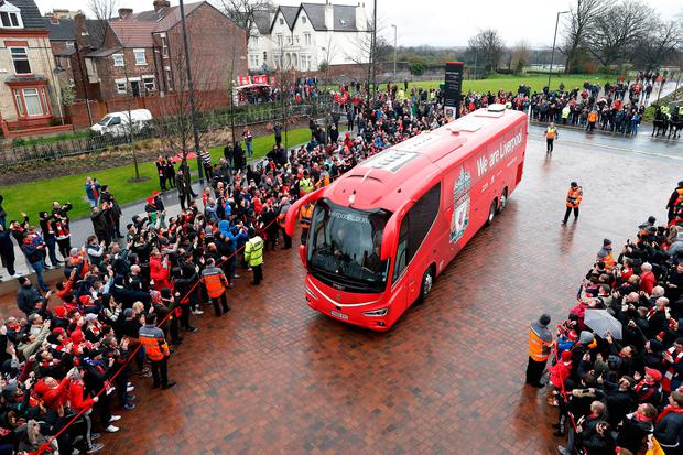 The Liverpool coach arrives before the match against Everton