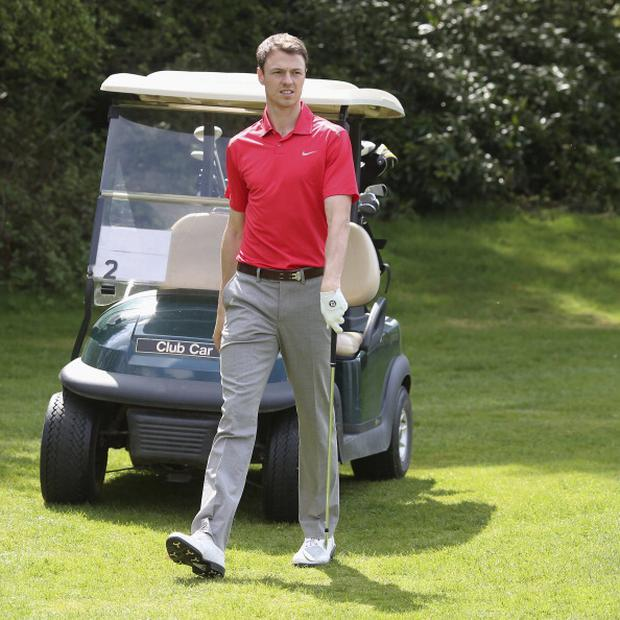 Jonny Evans of Manchester United takes part in a Players v Coaching Staff golf match at Dunham Massey Golf Club on May 7, 2013 in Manchester, England. (Photo by Matthew Peters/Man Utd via Getty Images)