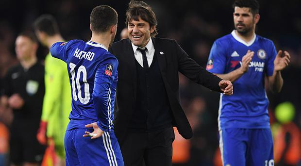 Antonio Conte manager of Chelsea celebrates victory with Eden Hazard of Chelsea after the match between Chelsea and Manchester United at Stamford Bridge. (Photo by Darren Walsh/Chelsea FC via Getty Images)