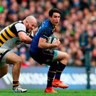 Leinster's Joey Carbery is tackled by Wasps' Jake Cooper-Woolley during the European Champions Cup quarter final at the Aviva Stadium