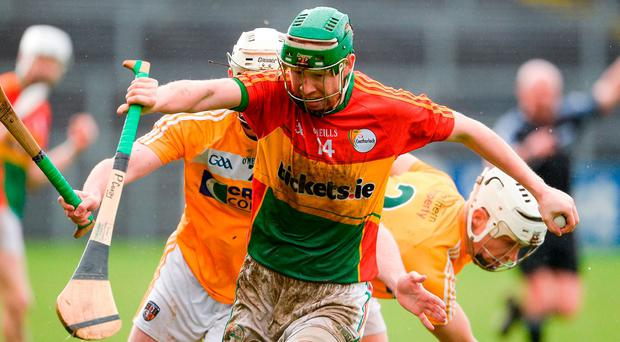 Paul Cody of Carlow in action against Paddy Burke and Stephen Rooney of Antrim during the Allianz Hurling League Division 2A Final match between Antrim and Carlow at Páirc Esler in Newry. Photo by Oliver McVeigh/Sportsfile