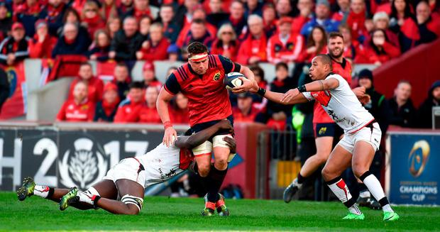 CJ Stander of Munster is tackled by Yacouba Camara of Toulouse during the European Rugby Champions Cup Quarter-Final match between Munster and Toulouse at Thomond Park, in Limerick. Photo by Eóin Noonan/Sportsfile