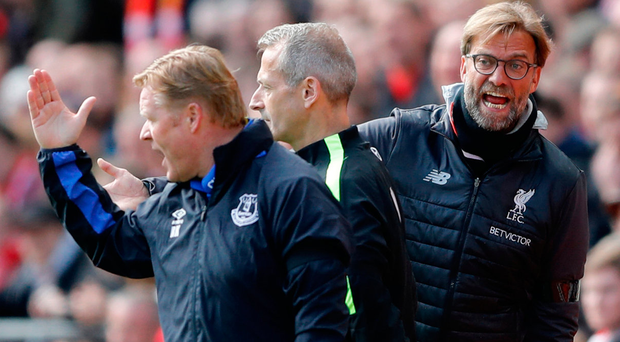 Liverpool manager Jurgen Klopp clashes with Everton boss Ronald Koeman at Anfield. Photo: Reuters