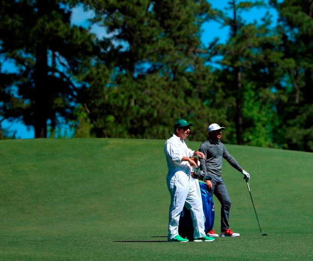 Rory McIlroy of Northern Ireland stands on the second fairway with his caddie J.P. Fitzgerald during the second round of the 2016 Masters Tournament at Augusta Photo: Andrew Redington/Getty Images