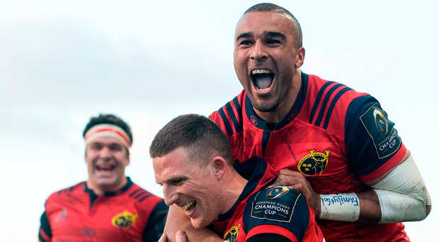 Andrew Conway celebrates with Simon Zebo after scoring Munster's fourth try against Toulouse. Photo: Eoin Noonan