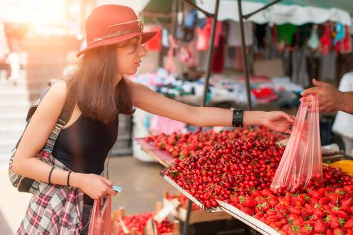 'Here's a vast difference between co-operate and corporate, though the spelling is almost identical. Country Markets' core belief that the whole community benefits from buying locally grown produce and crafted goods challenges this alienated age of corporate capitalism' Stock photo: Depositphotos