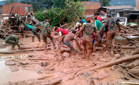 Colombian National Army, soldiers and residents work together in rescue efforts in Mocoa, Colombia, Saturday, April 1, 2017 (Colombian Army Photo via AP)