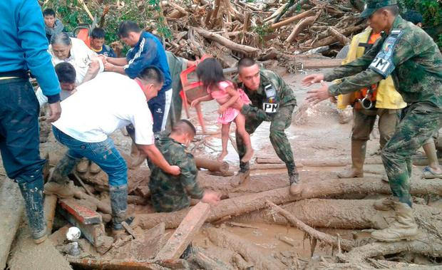 Colombian National Army, soldiers rescue a child in Mocoa, Colombia, Saturday, April 1, 2017 (Colombian Army Photo via AP)