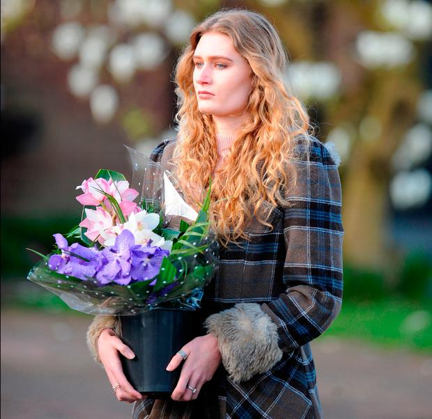 Lydia Wilkinson, the daughter of stabbing victims Peter and Tracey Wilkinson, arrives to lay flowers and view floral tributes at her family home in Stourbridge, West Midlands. Picture: Rui Vieira/PA Wire