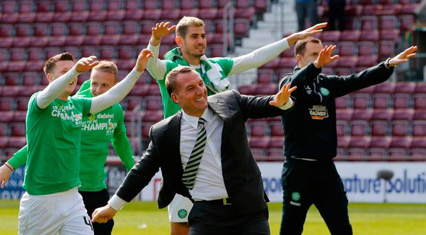 Celtic manager Brendan Rodgers and their players celebrate winning the Scottish Premiership Reuters / Russell Cheyne Livepic