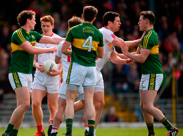 Players from both Kerry and Tyrone tussle off the ball