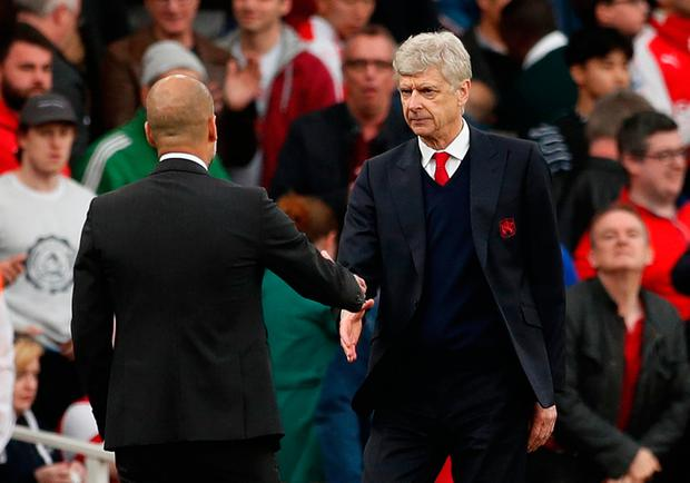 Arsene Wenger and Manchester City manager Pep Guardiola shake hands at full time
