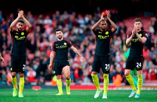 Manchester City's (from left to right) Gael Clichy, Sergio Aguero, Fernandinho and John Stones applaud the fans