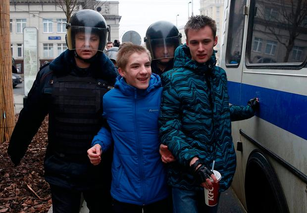 Policemen detain young men while patrolling streets in the case of an anti-government protest, which was not sanctioned by the authorities, in Moscow, Russia, April 2, 2017. REUTERS/Maxim Shemetov