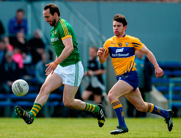 Meath's Graham Reilly attempts to escape Clare's Cian O'Dea Photo: Diarmuid Greene/Sportsfile