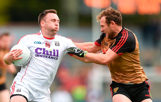 Paul Kerrigan of Cork and Down's Darren O'Hagan battle for control of the ball Photo: Eóin Noonan/Sportsfile