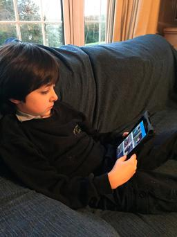 Jacob Cotter, aged 7 who has autism, using Avail on his tablet