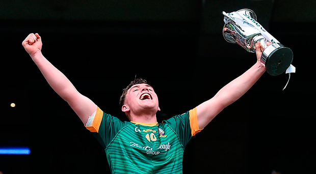 Dara Moynihan, captain of St Brendan's College, celebrates with the Hogan Cup Photo: Matt Browne/Sportsfile
