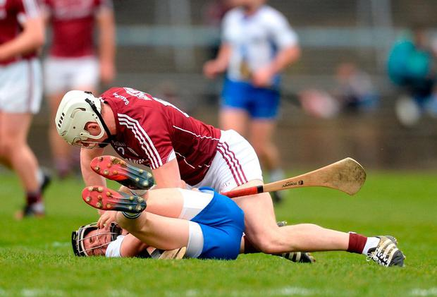 Galway's Joe Canning and Waterford's Conor Gleeson tussle off the ball during their Allianz NHL quarter-final in Pearse Stadium. Photo: Piaras Ó Mídheach/Sportsfile