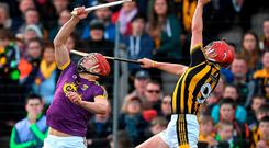 Wexford's Lee Chin contests possession with Cillian Buckley during yesterday Allianz NHL quarter-final in Nowlan Park. Photo: Brendan Moran/Sportsfile