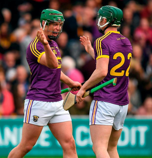 Wexford's Conor McDonald celebrates with team-mate Harry Kehoe at the final whistle. Photo: Brendan Moran/Sportsfile