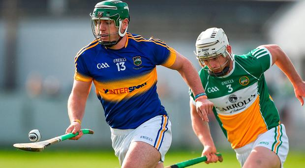 Tipperary's John O'Dwyer in action against Offaly's Michael Cleary. Photo: David Maher/Sportsfile