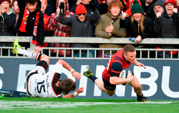 Andrew Conway of Munster scores his side's fourth try despite the efforts of Toulouse's Maxime Medard Photo: Diarmuid Greene/Sportsfile
